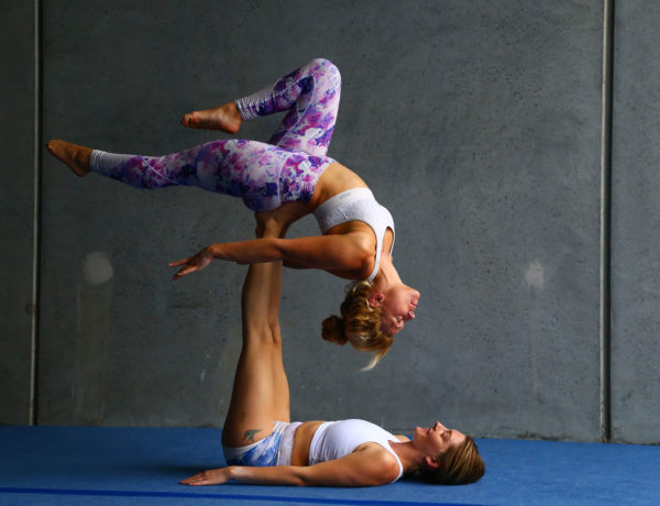 Two People Performing Acrobatics